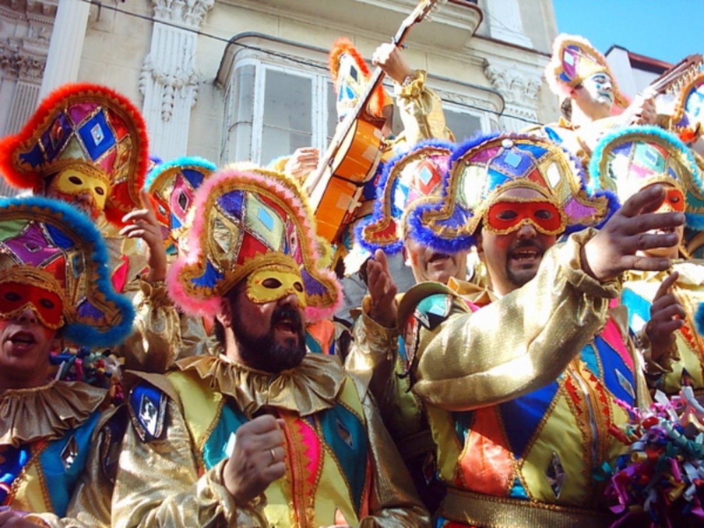 Group of men in costume singing on the Cadiz Carnival Day Trip